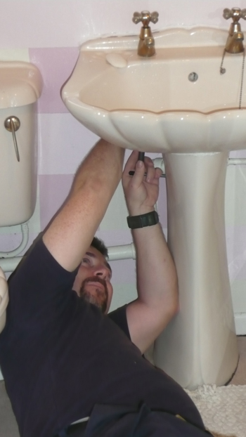 a photo of Frank fitting a sink.